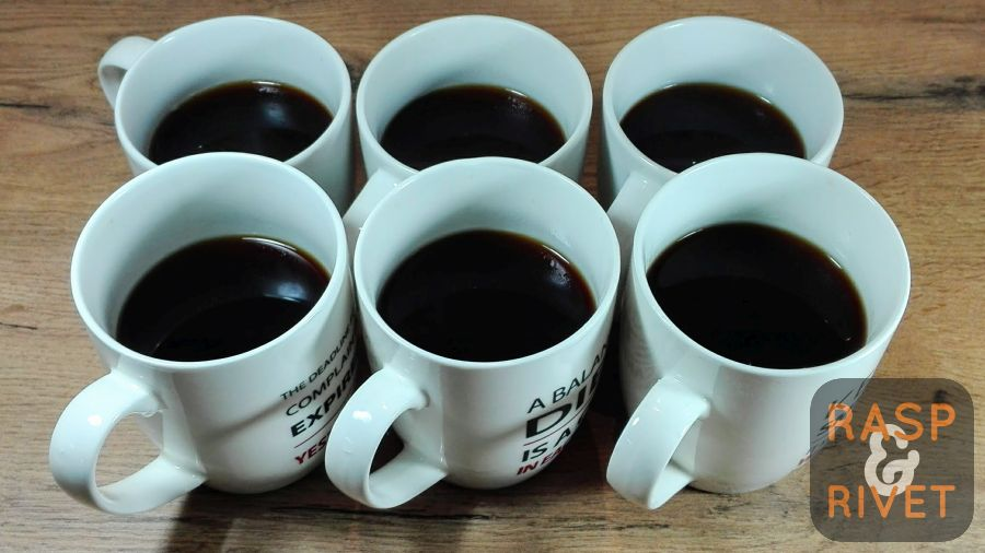 Top up the cups with hot water. There you go. Six cups of Americano from one AeroPress press