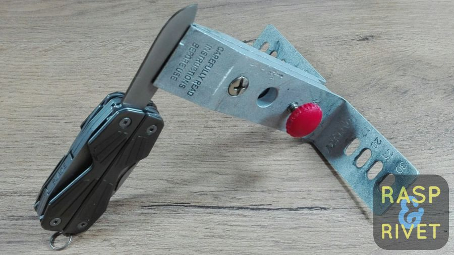 The Gerber mini multi tool clamped in the Lansky