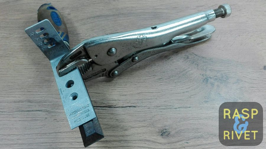 The chisel fastened to the Lansky clamp with a vice grip