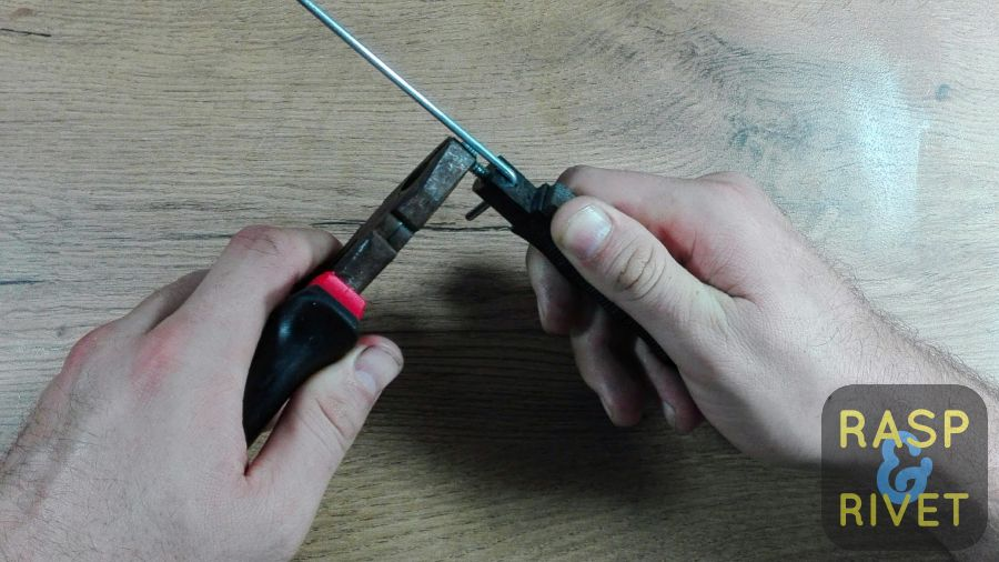 Tighten the guide rod using pliers