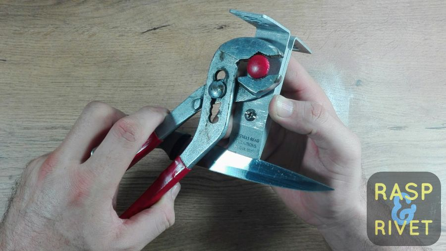 Tighten the knurl knob screw with a pair of pliers