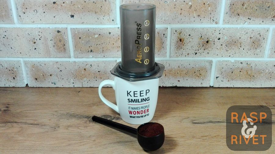 Add two scoops of coffee grounds to the water chamber
