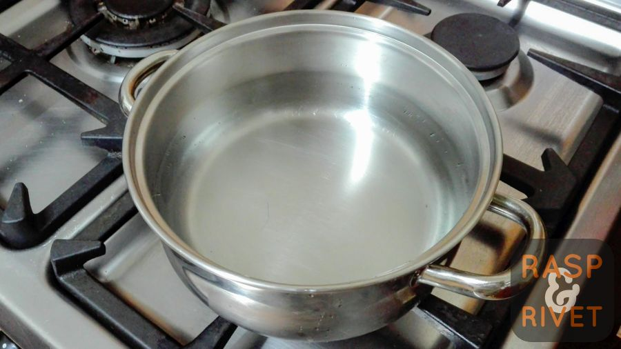 Fill a pot with water and place it on the stove over an open flame