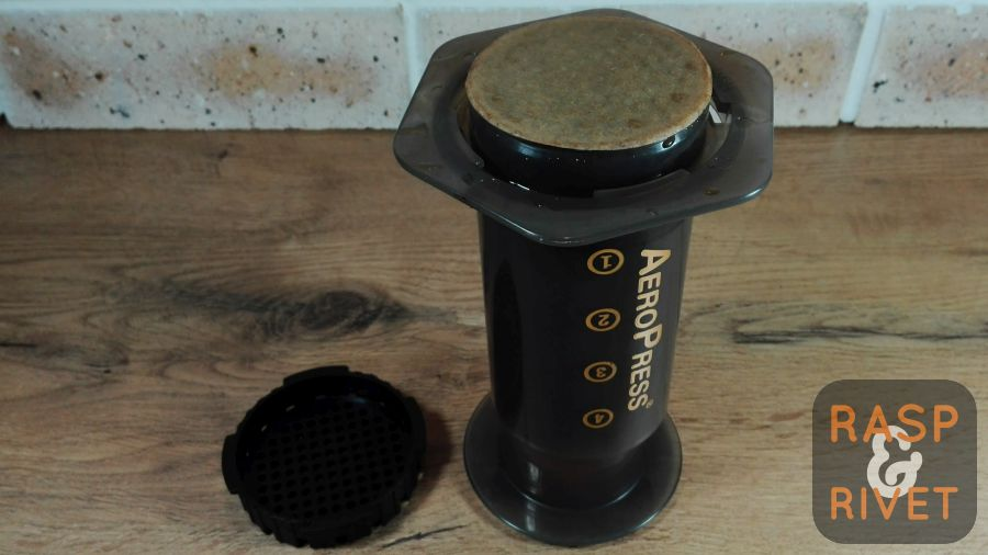 The filter cap removed from the AeroPress