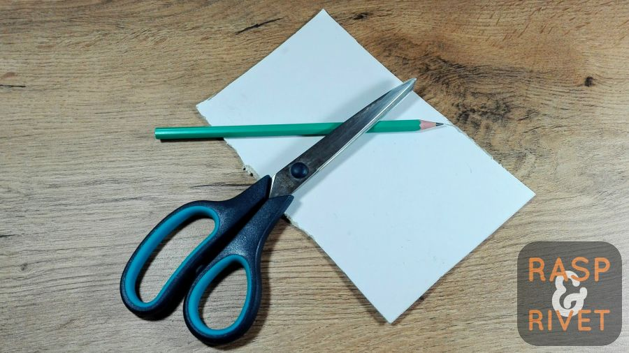 Tools needed for making AeroPress filters: pair of scissors, a pencil and 1.2mm thick cardboard