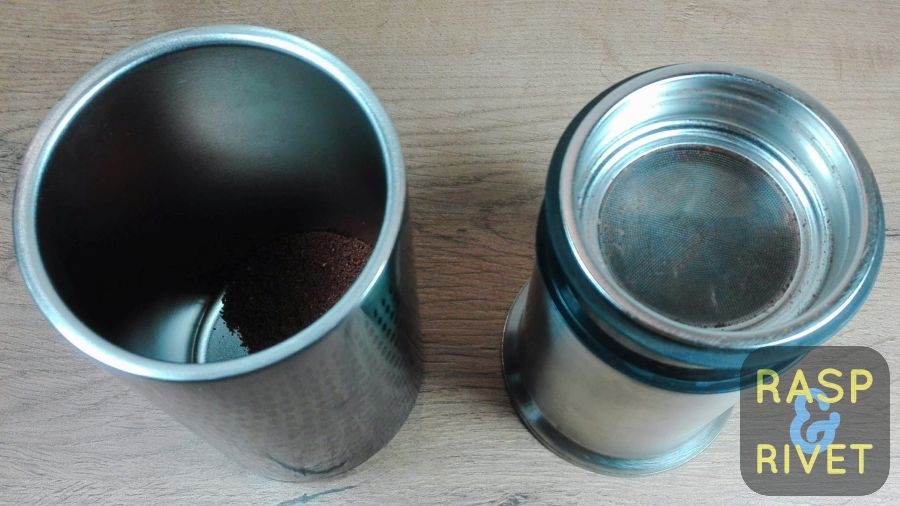 The 10g of coffee transferred from the plunger to the tumbler