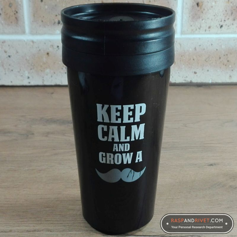 The cheap plastic travel mug my wife bought me a few years ago. It says KEEP CALM AND GROW A MOUSTACHE on the side of the mug