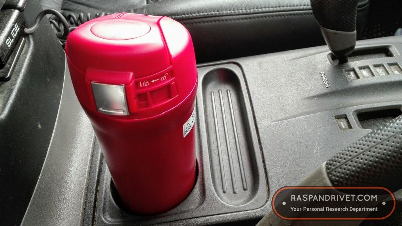 The Zojirushi inside a Mitsubishi Pajero's cup holder