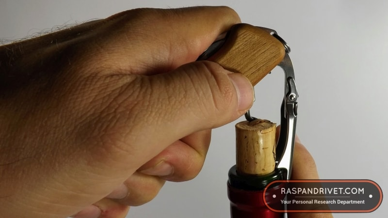 Lever the cork out of the bottle by lifting the Wine Master by its handle