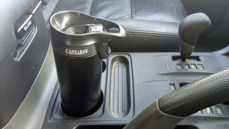 The CamelBak inside a Mitsubishi Pajero's cup holder